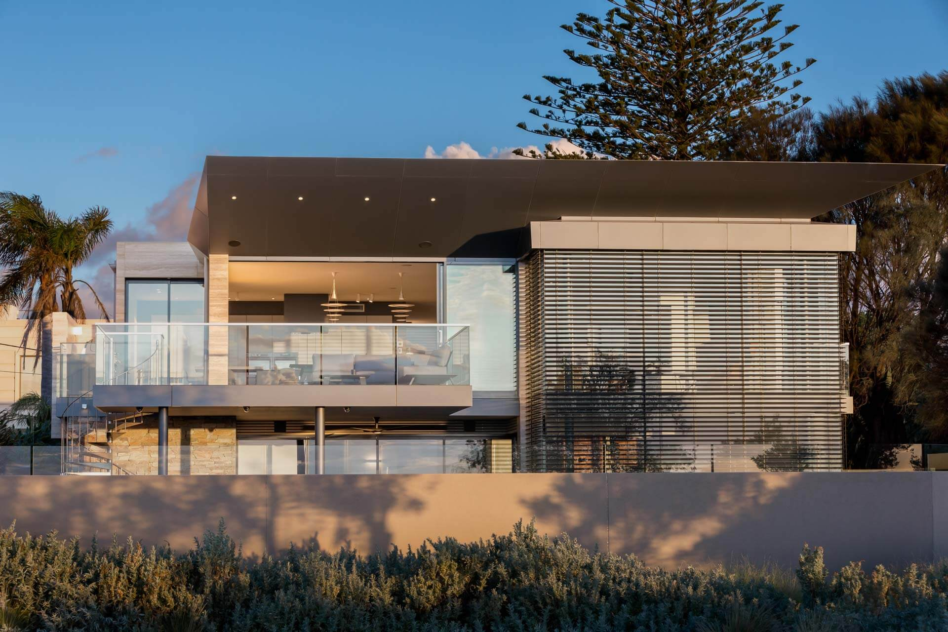 late afternoon photo of Custom designed contemporary renovation in Brighton bayside home showing internal illumination in melbourne by Roger Thompson Photography