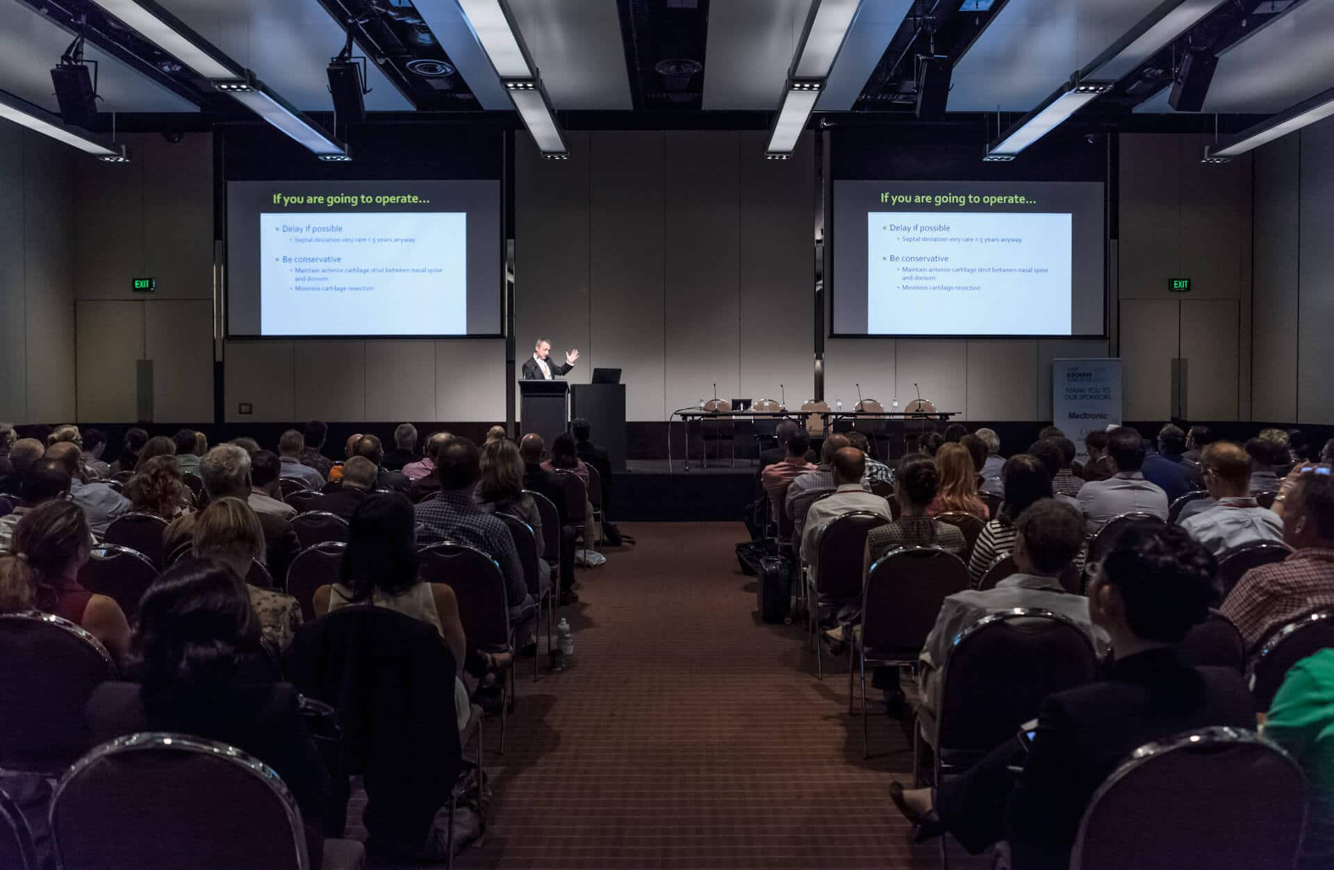 large event room with doctor speaker event photograph from asohns crown conference in melbourne