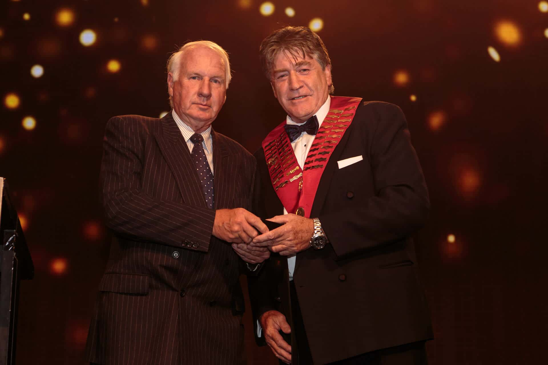 Asohns president speaker handing an award to doctor on stage event photograph from asohns crown conference in melbourne