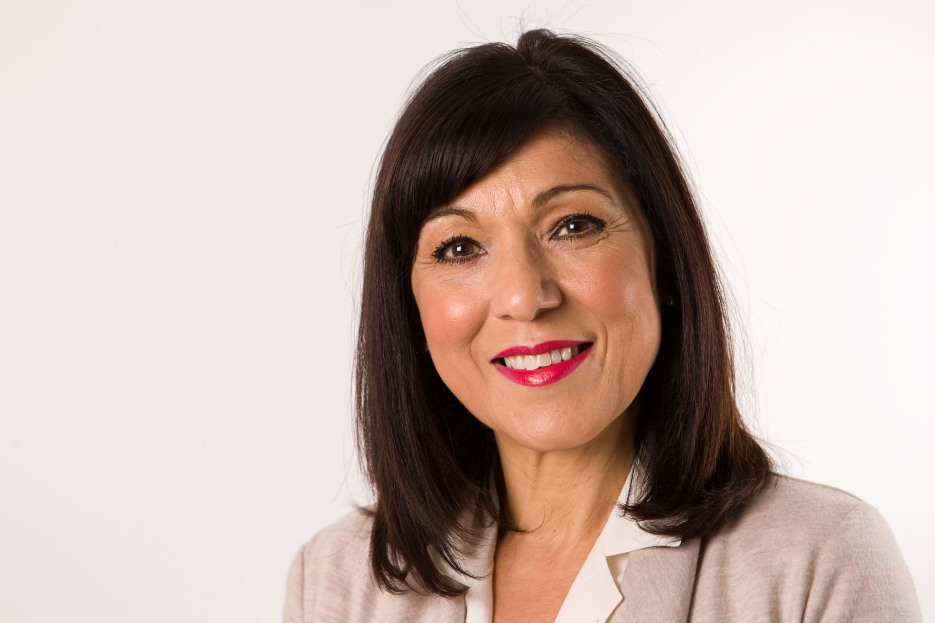 professional corporate portrait head shot of mature dark haired lady with red lipstick