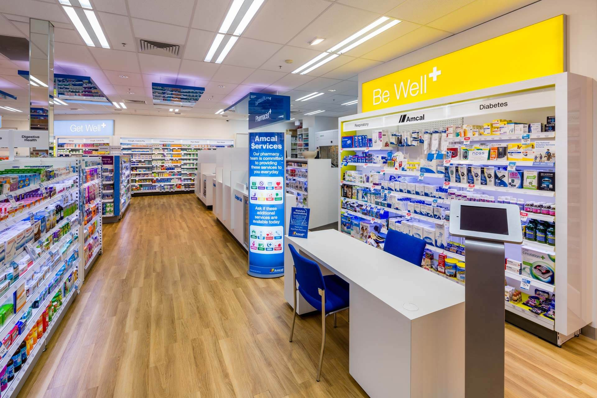 amcal+ pharmacy internal photograph of be well product area and pharmacy serving bays by sigma pharmaceuticals in stud park shopping centre