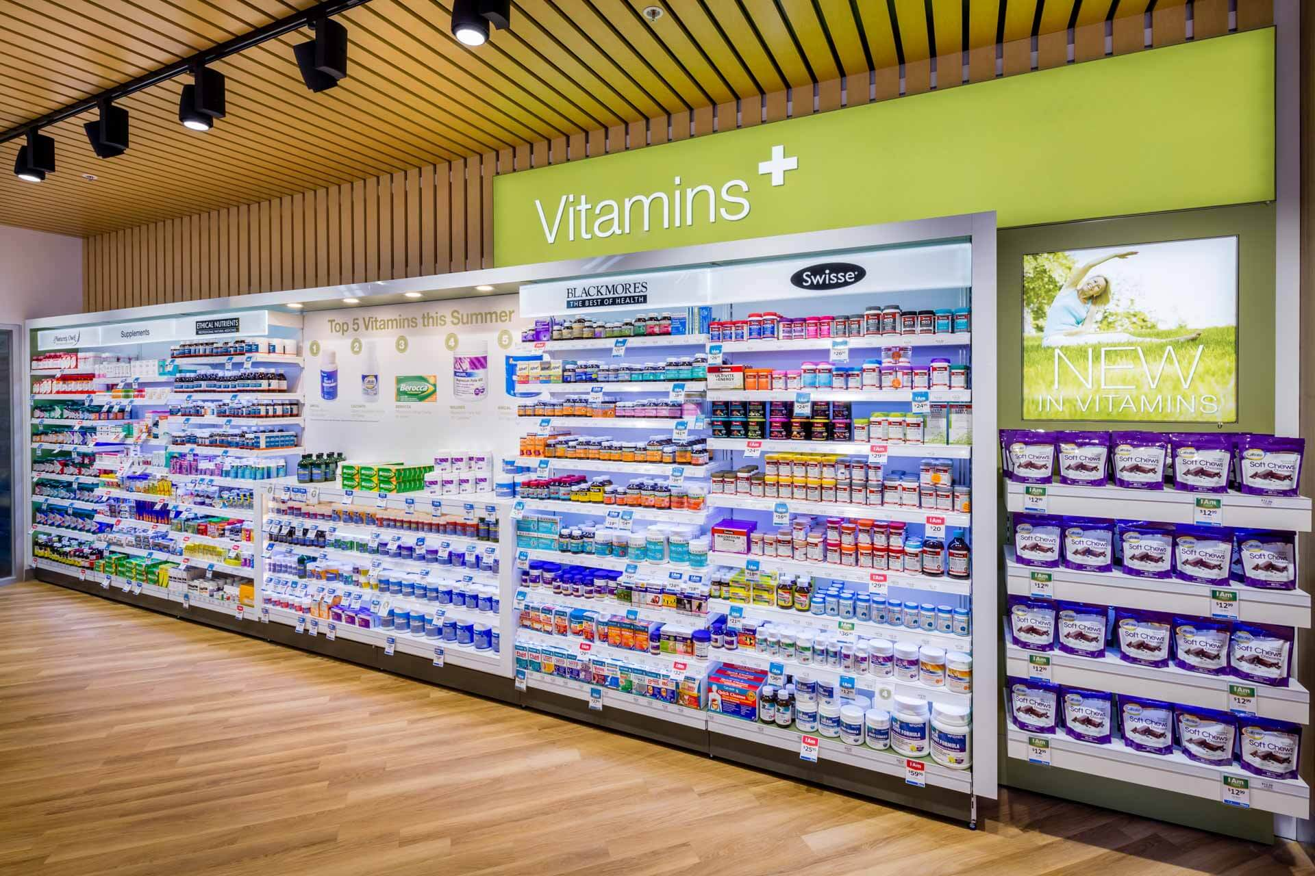 amcal+ pharmacy internal photograph of vitamin product area by sigma pharmaceuticals in stud park shopping centre