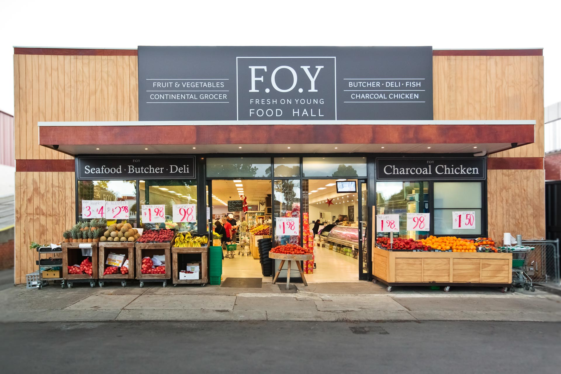 Architectural photograph of fresh food business fresh on young store store front with road and customers in store