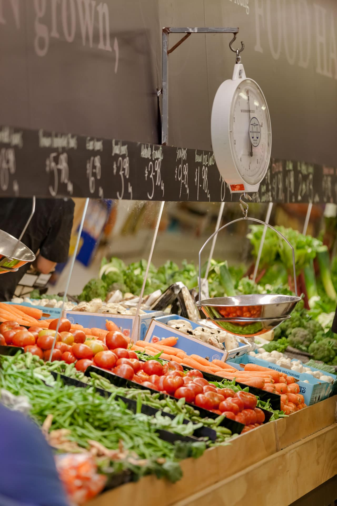workplace photograph of fresh food business fresh on young store showing fruit and vegetables produce on display with weighing scales