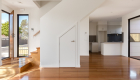 interior photography of West Footscray townhouse new development, architectural design, solid wood floor, white walls, roger thompson photography,, living area, kitchen, front door