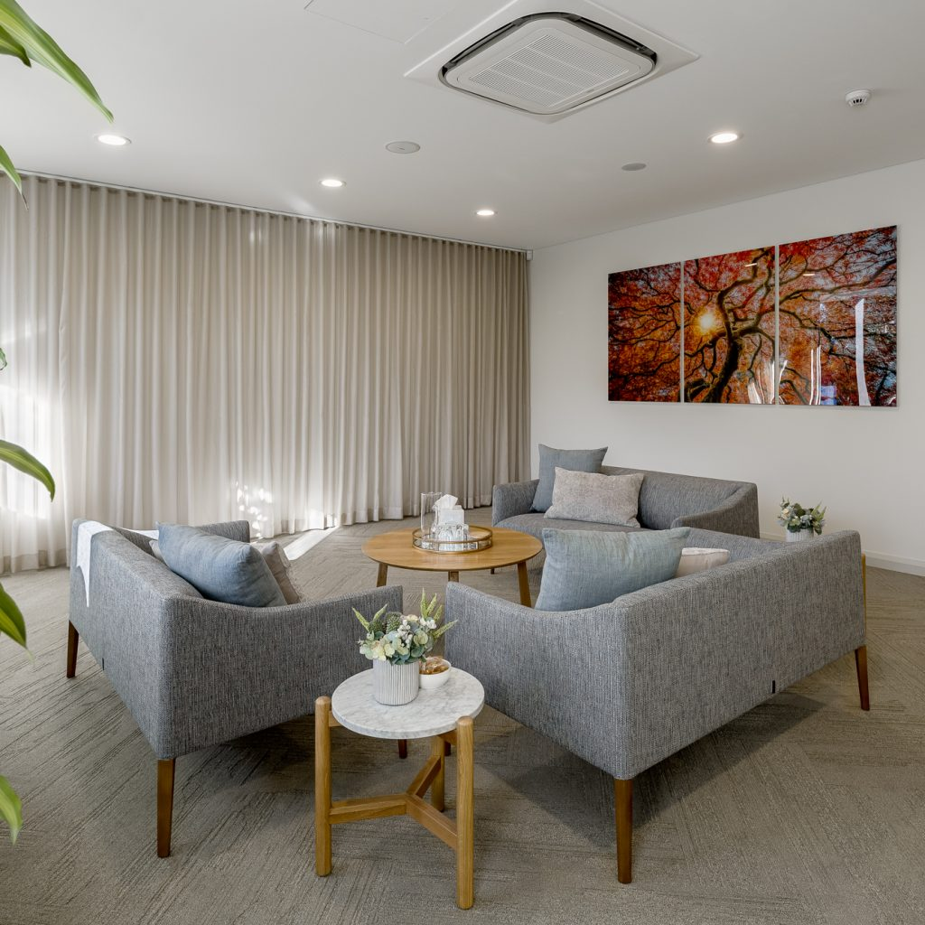 Le Pine and white lady funeral home family meeting room internal photo showing seating area by Roger Thompson Photography Melbourne