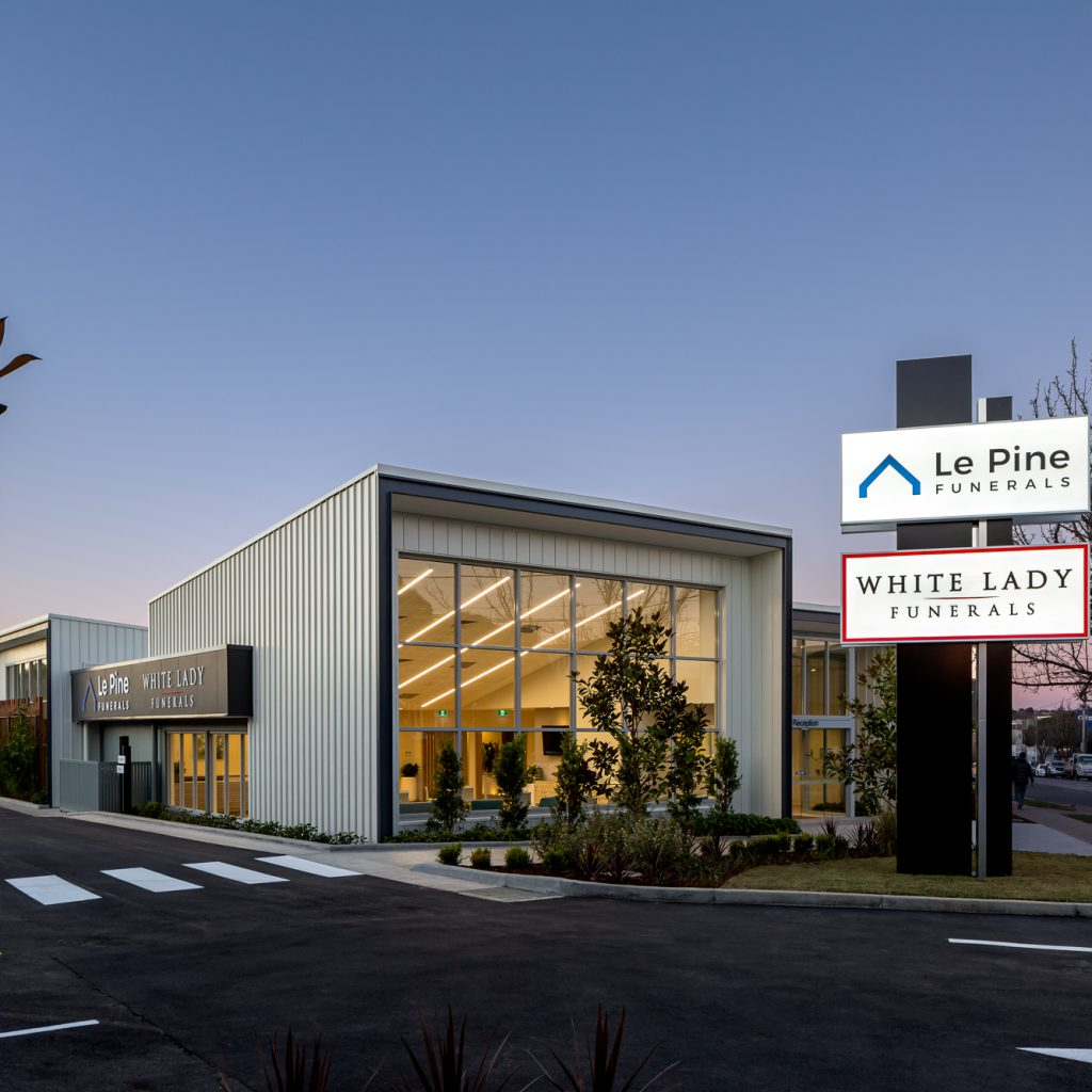Le Pine and white lady funeral home  front view dusk exterior photo by Roger Thompson Photography Melbourne