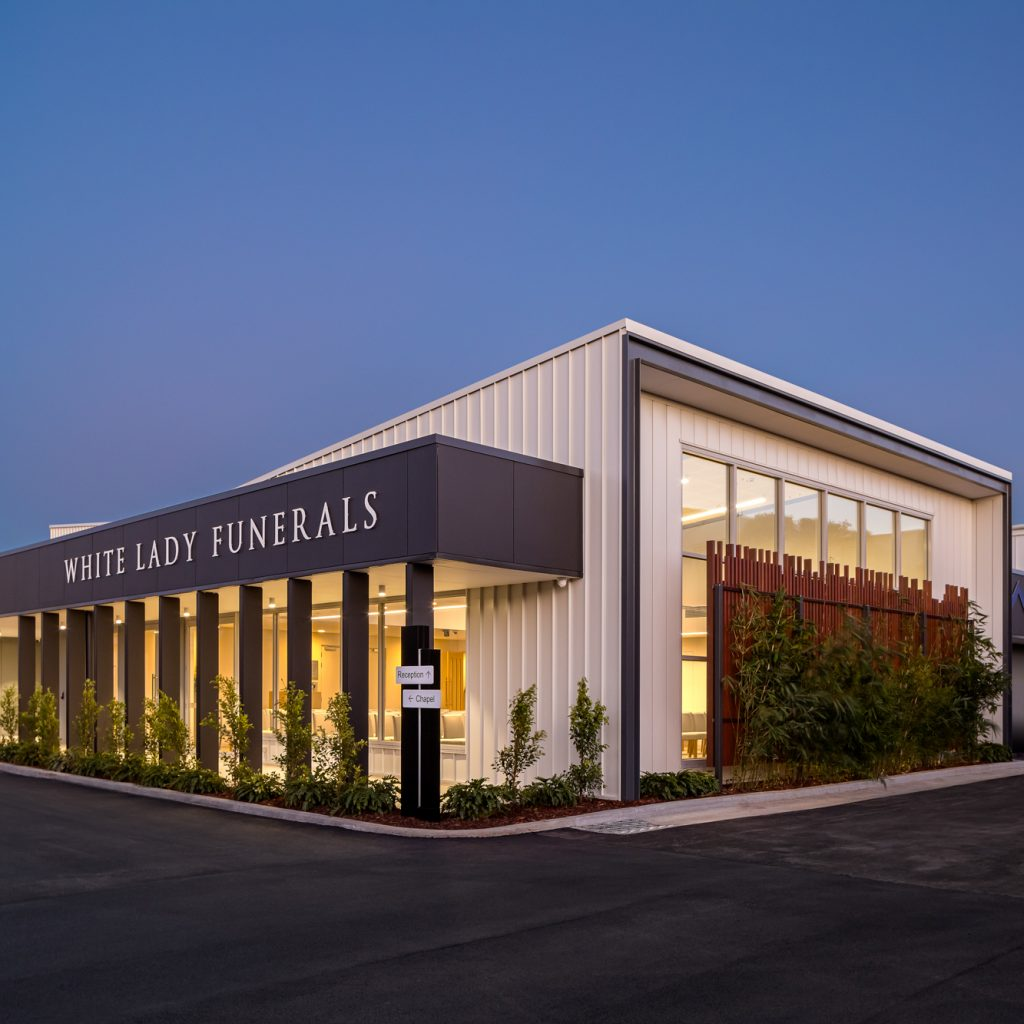 Le Pine and white lady funeral home side view dusk exterior photo by Roger Thompson Photography Melbourne
